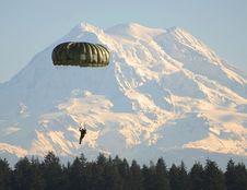 Free Man Flying On Parachute Near Green Trees Stock Photos - 96793733