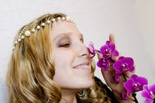 Free Blond Girl With Orchid Stock Image - 9681491