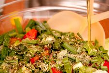Free Salad With Herbs Adding Oil Royalty Free Stock Photos - 9681938