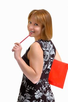 Smiling Woman With A Pencil In Hands Royalty Free Stock Image