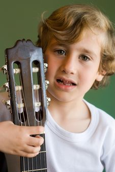 Free Young Cute Boy With Guitar Royalty Free Stock Images - 9685659