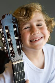 Free Young Cute Boy With Guitar Royalty Free Stock Photography - 9685737