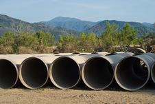 Free Dewage Pipes With Mountain Background Royalty Free Stock Photo - 9687235