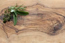 Herbs On A Wooden Board Royalty Free Stock Photography