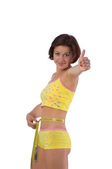 Free Cute Girl Measuring Her Small Waist Royalty Free Stock Photo - 9697875