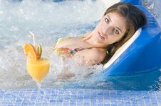 Beautiful Woman In A Water Bed In Spa Center