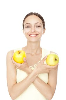 Free Young Happy Woman Holding Two Apples Stock Photos - 9699743
