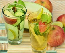 Free Clear Glass Cup With Fruits And Water Inside Beside Slice Fruitas Royalty Free Stock Images - 96932889