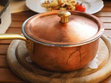 Free Brown Lidded Cooking Pot On Gray Round Wooden Coaster Royalty Free Stock Images - 96932989
