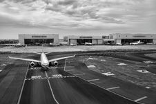 Free Gray Scale Of Air Plane On Runway Under Cloudy Day Royalty Free Stock Photos - 96933068