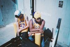 Free Man Wearing Yellow La Lakers Jersey Sitting Next To Man Wearing Yellow Basketball Jersey Stock Photo - 96933190