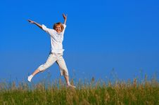 Free Beauty Girl Jumping In Field Stock Photography - 976992