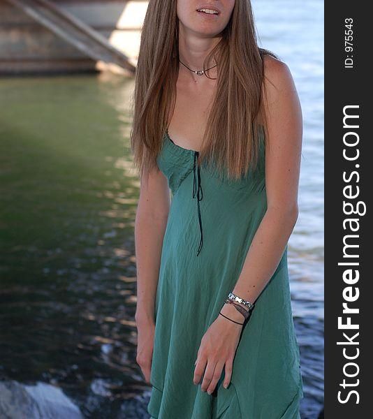 Summer girl under a boat dock