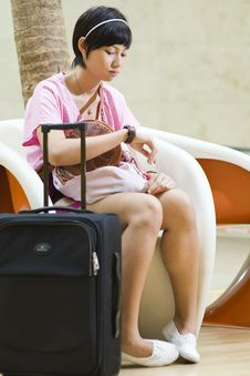 Free Young Asian Girl Waiting At The Airport Royalty Free Stock Photography - 9700997