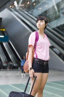 Free Asian Girl At Singapore S Changi Airport Terminal Royalty Free Stock Photo - 9701015
