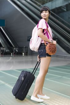Free Asian Girl At Singapore S Changi Airport Terminal Royalty Free Stock Photography - 9701037
