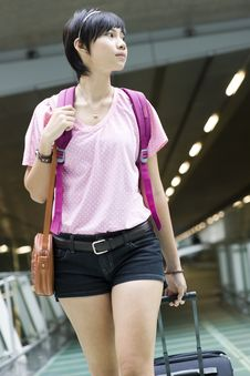 Free Asian Girl At Singapore S Changi Airport Terminal Stock Images - 9701194