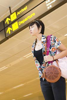 Free Asian Girl At Singapore S Changi Airport Terminal Royalty Free Stock Photo - 9701485