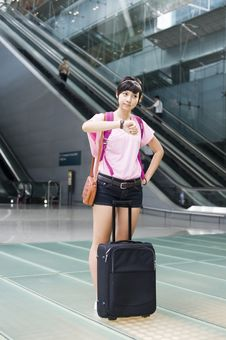 Free Asian Girl At Singapore S Changi Airport Terminal Stock Images - 9701774