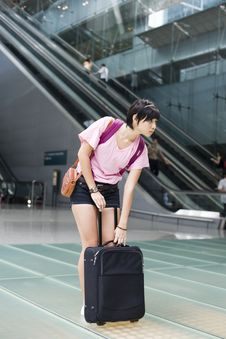 Free Asian Girl At Singapore S Changi Airport Terminal Royalty Free Stock Photos - 9701778