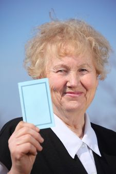Free Aged Woman Holds Card In Hand Stock Photos - 9704493