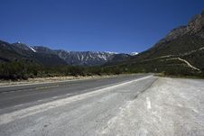 Free Empty Freeway With The Mountains On A Horizon Stock Photo - 9705350