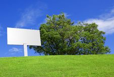 Free Billboard Against A Beautiful Landscape Royalty Free Stock Photos - 9707428