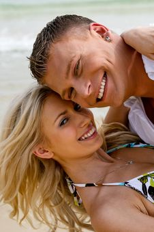 Free Cheerful Couple At Ocean Stock Images - 9709294