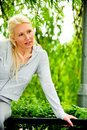 Free Beautiful Blond Female Relaxing In The Park Stock Image - 9715291