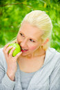 Free Beautiful Blond Female Relaxing In The Park Royalty Free Stock Photography - 9715457