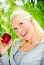 Free Beautiful Young Woman Enjoying A Healthy Red Apple Stock Image - 9715621