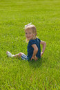 Free Little Girl Sitting In Grass Stock Photos - 9717793