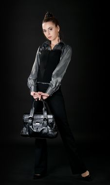 Free Young Girl With Bag Posing In The Studio Stock Image - 9710371