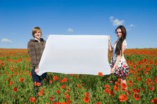 Free Beautiful Couple In The Poppy Field Royalty Free Stock Photos - 9710838