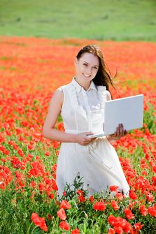 Free Attractive Smiling Girl With Laptop Royalty Free Stock Images - 9710959