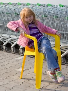 Free Girl On A Plastic Chair Royalty Free Stock Image - 9714266