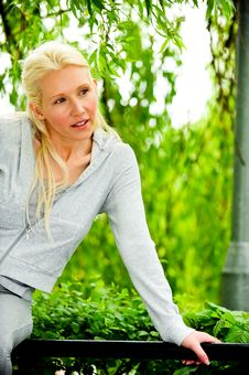 Beautiful Blond Female Relaxing In The Park Stock Image