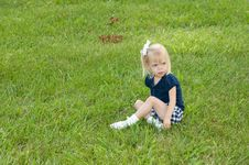 Free One Girl Sitting In Grass Royalty Free Stock Photo - 9718475