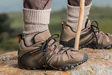 Free Men S Brown And Gray Merrell Hiking Shoes Holding Stick Royalty Free Stock Photo - 97187555