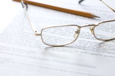 Free Close-up Of Document, Eyeglasses And Pencil. Stock Photography - 9721992