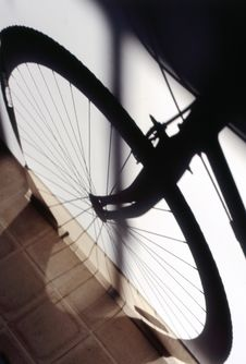 Copyright Shadow Of The Front Wheel Of A Bicycle Stock Photos