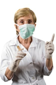 Free Mature Woman Doctor Pointing Upwards Stock Photos - 9729953