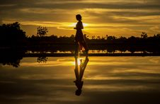 Free Silhouette Of Man Standing On Lake At Sunset Royalty Free Stock Images - 97208479
