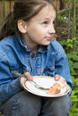 Free Pretty Young Girl Sitting With Plate Royalty Free Stock Images - 9735559