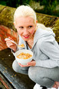 Free Young Woman Eating A Bowl Of Cereal Royalty Free Stock Photography - 9739717