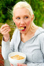 Free Young Woman Eating A Bowl Of Cereal Royalty Free Stock Photos - 9739728