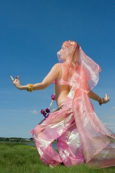 A Woman In Pink Dancing On The Grass Royalty Free Stock Image