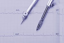 Free EKG Printout And Compasses Stock Image - 9732831