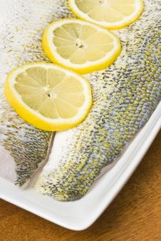 Free Raw Pickerel Fish Fillets With Sliced Lemon Stock Image - 9736491