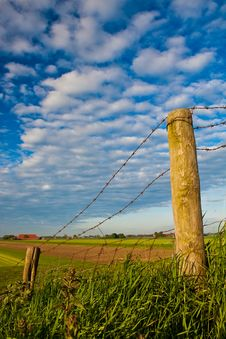 Free Countryside With Barbed Wire Fence Royalty Free Stock Image - 9737036